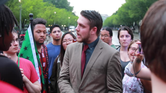 protesters in opposition to the unite the right 2 rally organized by white nationalist jason kessler at lafayette park near the white house gather to... - racism stock videos & royalty-free footage