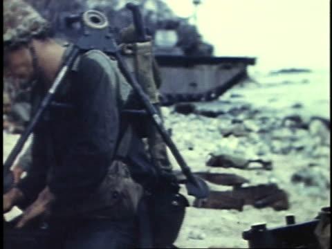 august 15 1944 ms marines checking ammunition and loading machine guns / peleliu palau - einige gegenstände mittelgroße ansammlung stock-videos und b-roll-filmmaterial