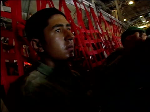 vidéos et rushes de august 15, 2004 shaky close up sweaty young afghan soldier on plane en route from kabul to shinand/ audio - opération enduring freedom