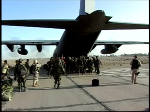 August 15, 2004 Wide shot Afghan soldiers disembarking from plane/ Shindand, Afghanistan/ AUDIO