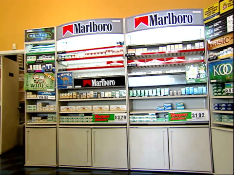 august 16, 2006 corner of store with shelves of cigarettes / united states - sachet stock videos & royalty-free footage