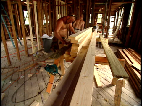 august 16, 2006 montage construction workers rebuilding a house / new orleans, louisiana, united states - rebuilding stock videos & royalty-free footage
