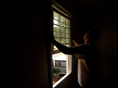 August 16 2006 MONTAGE Worker installing a new window in a house / New Orleans Louisiana United States