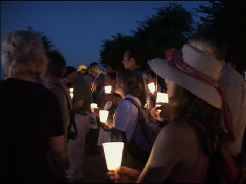 august 17 2005 medium shot zoom in antiwar protestors singing 'amazing grace' at candlelight vigil at camp casey / crawford texas / audio - 2005 stock videos & royalty-free footage