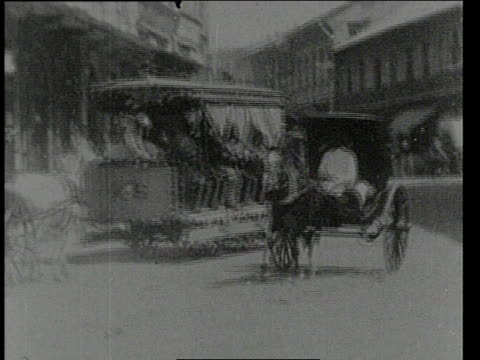 august 19, 1903 b/w escolta street with horse-drawn carriages and pedestrians / manila, philippines - 1903 stock-videos und b-roll-filmmaterial