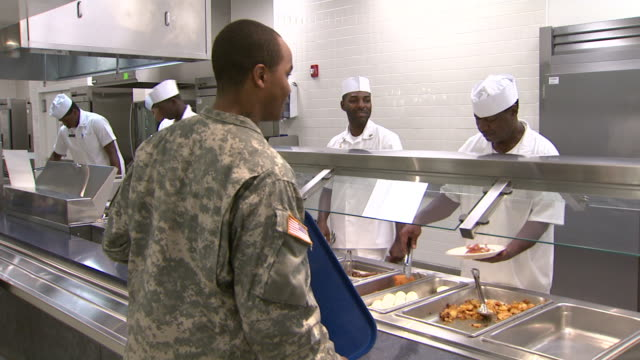 august 19 2008 ts army soldier at dining hall going through chow line / fort stewart georgia united states - fort stewart stock videos & royalty-free footage