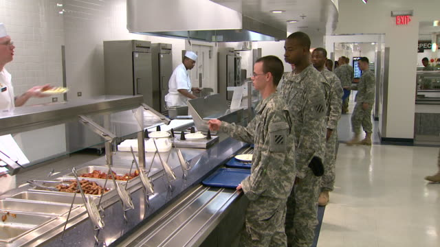 august 19 2008 pan army soldiers going through the chow line in dining hall / fort stewart georgia united states - fort stewart stock videos and b-roll footage