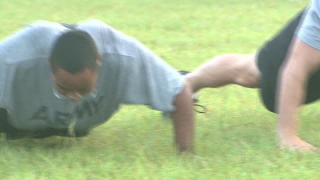 august 19, 2008 army soldiers performing push-up exercises then sprinting away / fort stewart, georgia, united states - fort stewart stock videos & royalty-free footage