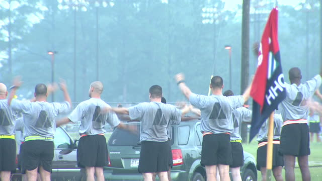 august 19, 2008 shaky army soldiers performing morning upper-body exercises / fort stewart, georgia, united states - 2000s style stock videos & royalty-free footage