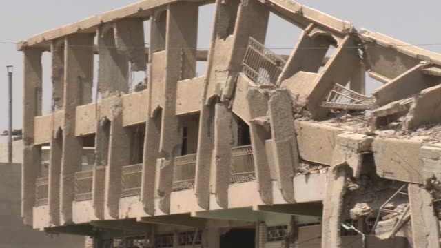 august 19, 2010 partially crumbling remains of a building, possibly battle damage / fallujah, iraq - al fallujah bildbanksvideor och videomaterial från bakom kulisserna