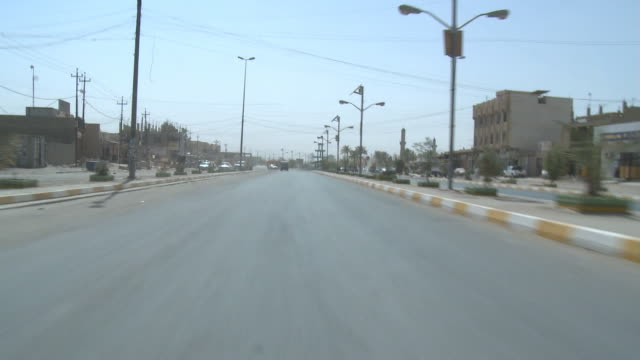 august 19, 2010 rear view driving down wide boulevard / fallujah, iraq - al fallujah stock videos & royalty-free footage