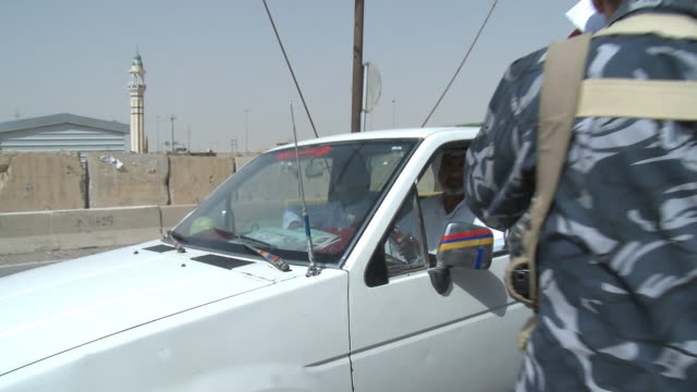 august 19, 2010 security detail stopping and checking papers from driver of a small pickup truck at checkpoint / fallujah, iraq - al fallujah bildbanksvideor och videomaterial från bakom kulisserna
