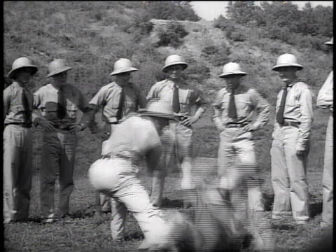 August 1942 MONTAGE instructor demonstrating judo throw to FBI agents / Washington, D.C., United States