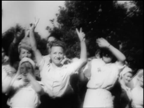 b/w august 1944 crowds cheering holding up two fingers in v sign / paris liberation - 1944 stock videos and b-roll footage