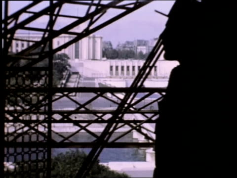 august 1944 montage the eiffel tower from within / paris, france - beleuchtungstechnik stock-videos und b-roll-filmmaterial