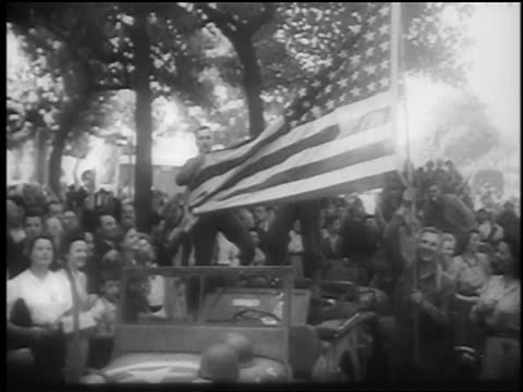 b/w august 1944 soldiers standing on offroad vehicle holding us flag / paris liberation / documentary - 1944 stock videos and b-roll footage