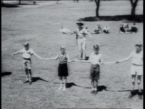 august 1951 montage cowboy teaching children how to use bullwhip - whipping stock videos & royalty-free footage