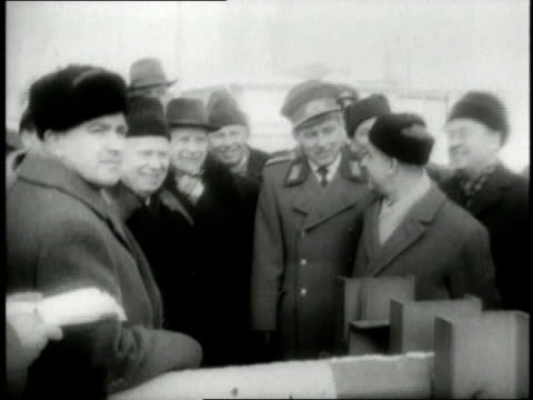 august 1961 montage nikita khrushchev visiting east berlin, waving as he walks through crowd / germany - 1961 stock-videos und b-roll-filmmaterial