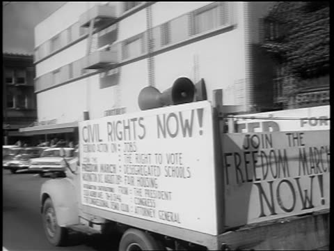 "august 1963 car point of view by truck with ""civil rights now"" sign + loudspeaker / documentary - black civil rights stock videos & royalty-free footage"