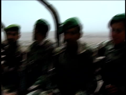 august 2004 closeup afghan national army soldiers riding in army vehicle/ afghanistan - afghan national army stock videos & royalty-free footage