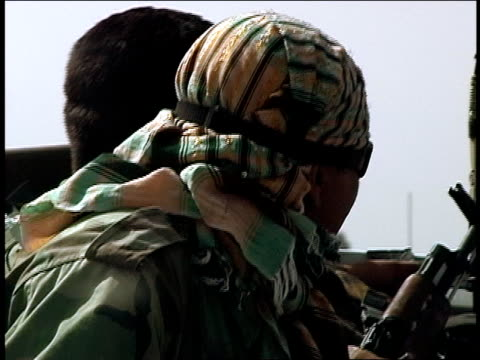 august 2004 closeup afghan national army soldiers riding in military vehicle on kabul kandahar highway/ afghanistan - operazione enduring freedom video stock e b–roll