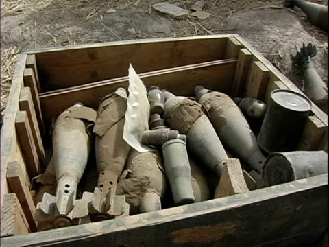 august 2004 closeup old missiles lying in heap in box / afghanistan - medium group of objects stock videos & royalty-free footage