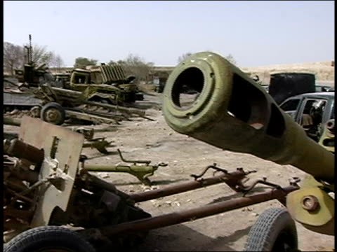august 2004 closeup pan abandoned cars and old weapons rusting in junkyard/ afghanistan - operazione enduring freedom video stock e b–roll