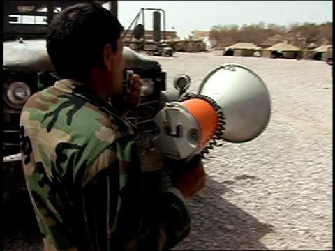 august 2004 medium shot afghan national army soldier speaking into megaphone/ afghanistan - afghan national army stock videos & royalty-free footage