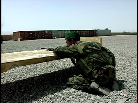 august 2004 medium shot afghan national army soldier throwing rocks at other soldiers in army vehicle during military training/ afghanistan - other stock videos & royalty-free footage