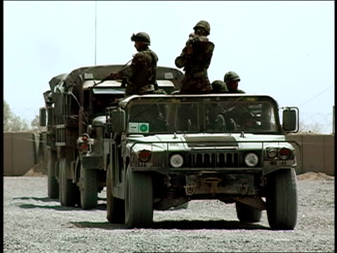 august 2004 medium shot afghan national army soldiers riding in army vehicle/ afghanistan - operazione enduring freedom video stock e b–roll