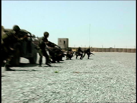 august 2004 medium shot afghan national army soldiers running with their rifles aimed during military training/ afghanistan - afghan national army stock videos & royalty-free footage