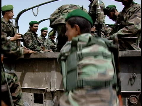 august 2004 medium shot low angle view afghan national army soldiers climbing onto army vehicle/ afghanistan - operazione enduring freedom video stock e b–roll