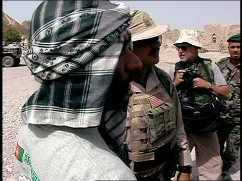 august 2004 medium shot pan afghan national army soldiers and american soldiers talking together/ afghanistan - afghan national army stock videos & royalty-free footage