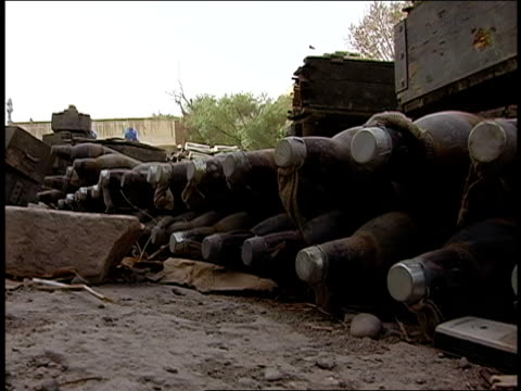 vídeos de stock, filmes e b-roll de august 2004 medium shot pile of old missiles lying on ground/ afghanistan - medium group of objects