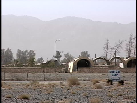 august 2004 medium shot sign outside camp shir zai afghan army barracks/ kandahar afghanistan - operazione enduring freedom video stock e b–roll