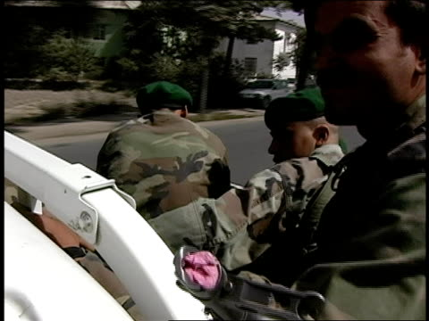 august 2004 medium shot three afghan national army soldiers riding in truck/ afghanistan - operazione enduring freedom video stock e b–roll