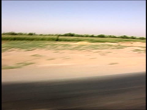 august 2004 tracking shot crops growing in fields along rural road/ afghanistan - unknown gender stock videos & royalty-free footage