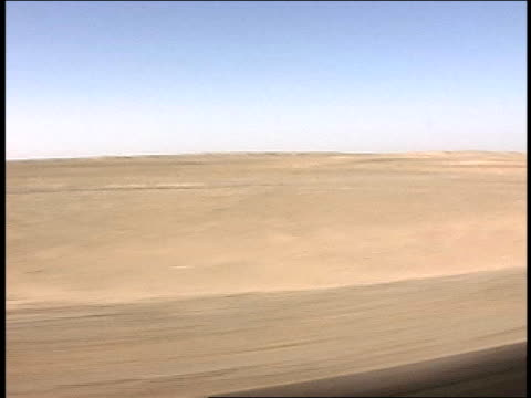 august 2004 tracking shot general view of barren landscape/ afghanistan - unknown gender stock videos & royalty-free footage