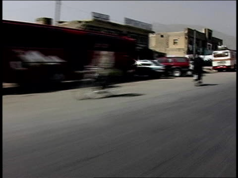 august 2004 tracking shot pedestrians walking along city street crowded with traffic/ afghanistan - unknown gender stock videos & royalty-free footage