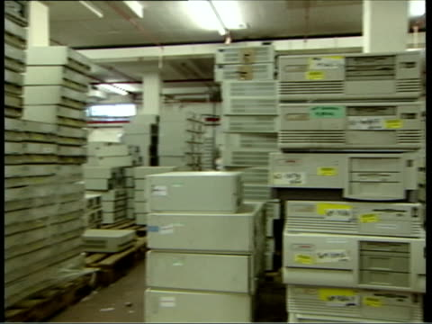 august 2006 montage ws pan stacks of computer cases waiting disposal/ ms stacks of computer keyboards on shelves/ uk/ audio - e waste stock videos & royalty-free footage