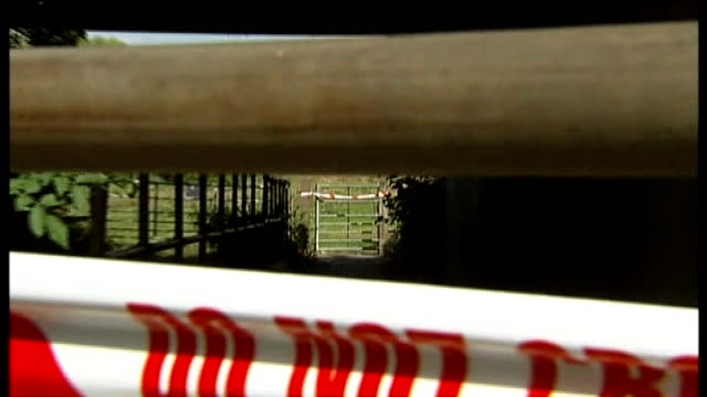 august 2007 cutaways farm gate tied up with cordon tape defra tape warning 'no entry' / police officer scrubbing shoes in bucket of disinfectant /... - scrubbing up stock videos and b-roll footage