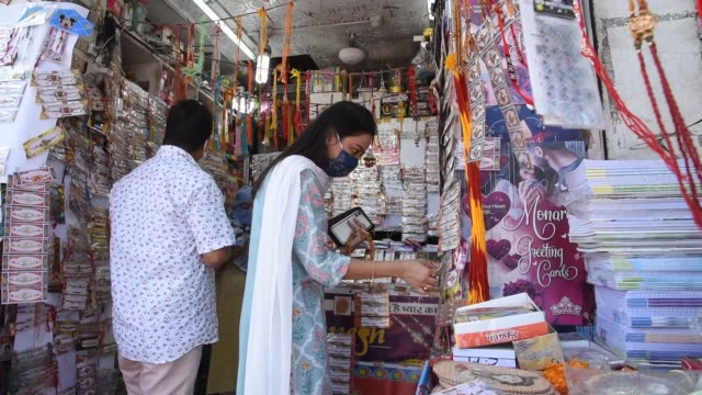 august 2020. customers at a rakhi store to buy rakhi in the occasion of raksha bandhan festival during covid-19 unlock 3.0, in guwahati on monday, 03... - beautiful woman stock videos & royalty-free footage