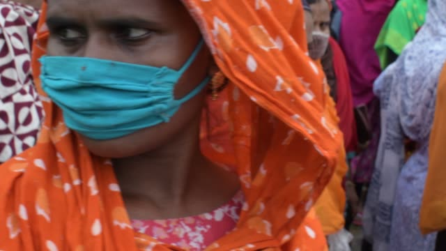august 2020: garments workers seeking work are waiting in front of a garment factory at gazipur on the outskirts of the capital dhaka. many of these... - employment issues stock videos & royalty-free footage