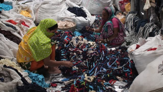august 2020: worker sorting through garment leftovers at a jhoot godown in savar near dhaka. the garment leftovers, called jhoot by the people... - garment stock videos & royalty-free footage