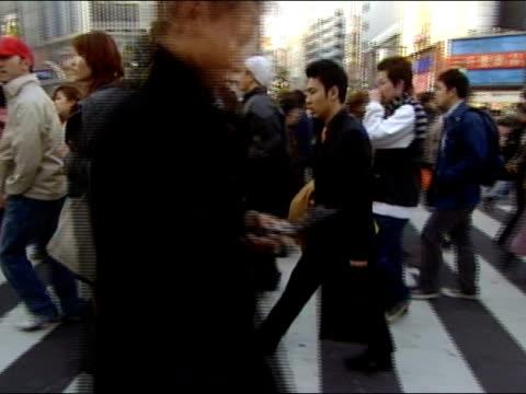 August 21, 2004 Crowd crossing street in Tokyo, Japan