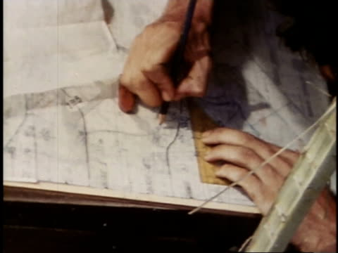 august 23, 1944 montage marine studying map of palau islands / russell islands, central province, solomon islands - medium group of objects stock videos & royalty-free footage
