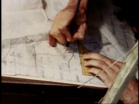 august 23 1944 montage marine studying map of palau islands / russell islands central province solomon islands - bordsyteinspelning bildbanksvideor och videomaterial från bakom kulisserna