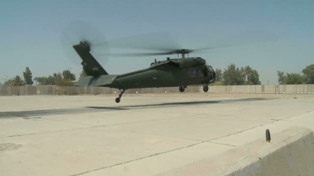 august 25, 2010 military helicopter landing and rolling on helipad / baghdad, iraq - ヘリポート点の映像素材/bロール