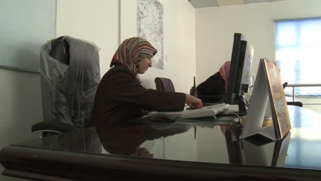 august 26, 2010 administrative employees working at desks at najaf international airport / najaf, iraq - najaf stock videos & royalty-free footage