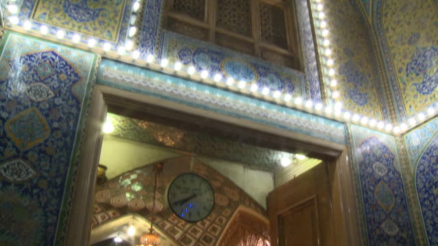 august 26, 2010 crowds of festival goers entering and leaving shrine at the close of ramadan / najaf, iraq - najaf stock videos & royalty-free footage